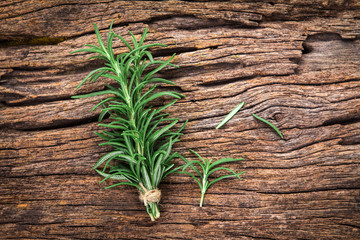 Fresh green Rosemary bound on a wooden board