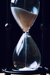 Hourglass on dark background. Close-up