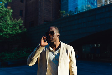 Young Black Businessman on the Phone Walkin on the Streets of Manhattan . New York City