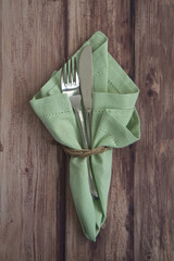 Table place setting with green serviette