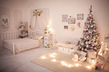 Christmas bedroom in shabby chic style. Decorated tree in cozy New Year interior design.