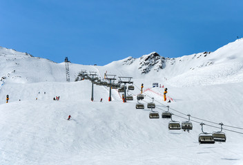 Skiers and chairlift in Solden, Austria