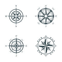 Set of vintage or old different style compasses