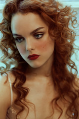 Portrait of woman with curled red hair