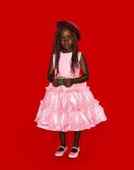 Girl wearing pink ruffle dress against red background