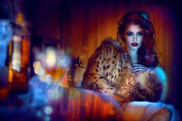 Woman wearing fur coat, portrait