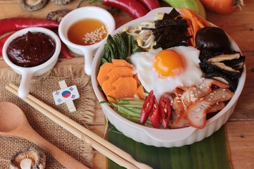 Bibimbap korean food is delicious on wood background.