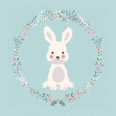 Cute baby bunny rabbit in Christmas flower and branch wreath