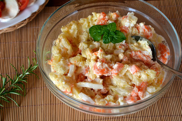 Homemade Potato Salad with Eggs and Carrots On A Glass Bowl On A Wooden Table Fototapete