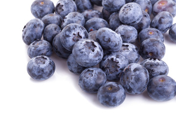 close up of blueberries on white background