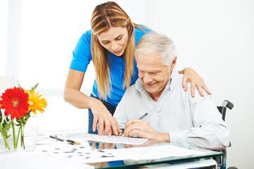 Senior man in wheelchair solving mazes