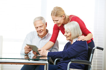 Senior couple using tablet computer