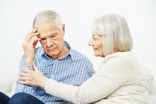 Old woman comforting senior man