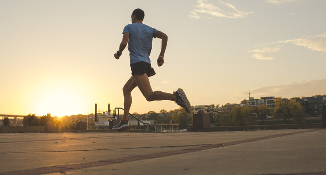 Man running, Harriet Island, Saint Paul, Hokah, Houston County, Minnesota, USA , back view