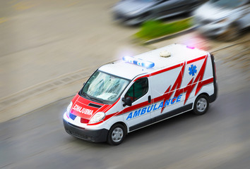 Ambulance van with flashing lights
