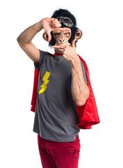 Superhero monkey man focusing with his fingers
