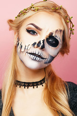 Girl with streaks on the face for Halloween