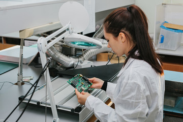 Microchip production factory. Technological process. Assembling the board. Computer and nanotechnology.