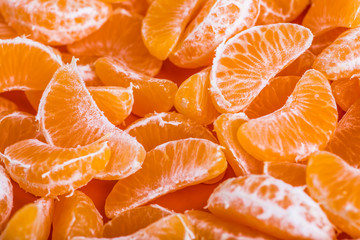 Tangerine segments, orange background texture