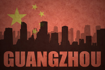 abstract silhouette of the city with text Guangzhou at the vintage chinese flag background