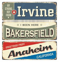 Vintage tin sign collection with USA cities. South. Irvine. Chicago. Retro souvenirs or postcard templates on rust background. Dixie.