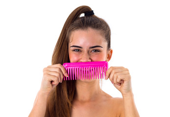 Young woman holding pink hair brush