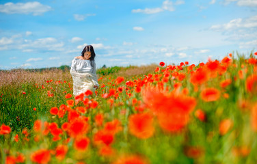girl walking in poppies
