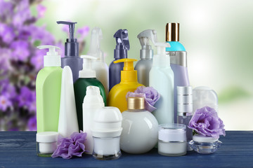 Set of body care products on lavender flowers background