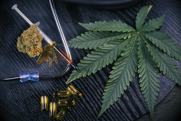 Medical marijuana products with cannabis leaf on black