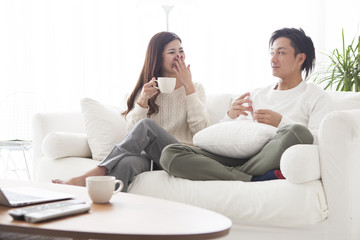 Young couple are talking happily in the living room