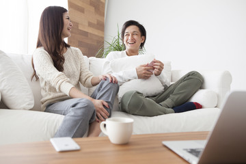 The couple are relaxing in the living room
