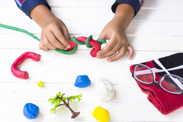 Child with Clay making animal in imagine with colorful clay and toy with etc.Top view and Zoom in