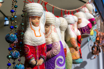 Kazakh felt decorations in the form of dolls