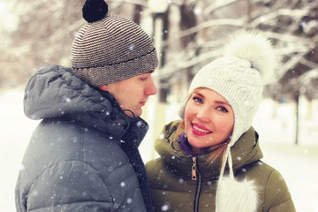 couple of young lovers walk in winter