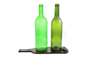 green glass bottles with one flat bottle