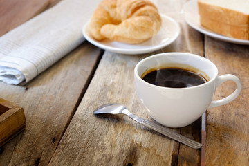 breakfast with croissants, cup of coffee.