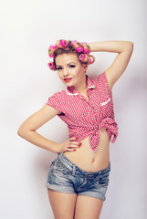 A girl dressed in pin-up style posing in studio