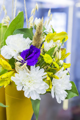 background blur bright colorful bouquet of flowers in bags at the florist shop