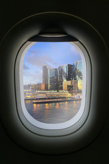 The window of airplane with travel destination attraction. Hongk