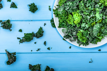 Green vegetable, leaves of kale from above on white plate