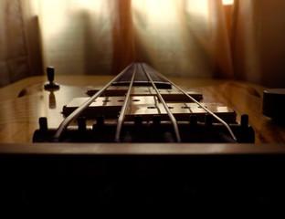Vintage bass guitar close on the bridge