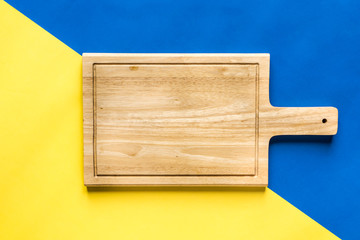 Top View of Cutting Board over Colorful Background