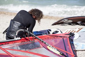 windsurfer prepares his windsurf