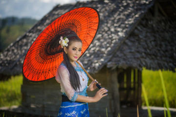 Beautiful asian girl in Myanmar traditional costume, with Red ba