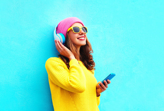 Fashion pretty sweet carefree girl listening to music in headpho