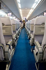 Airplane interior with chear rows