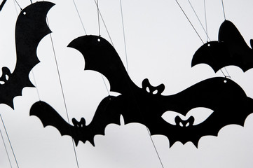 halloween silhouette of many black bats on a white background