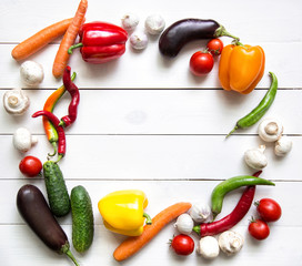 Fresh vegetables on white wooden table. Top view