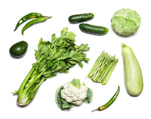 Green vegetables isolated on white top view