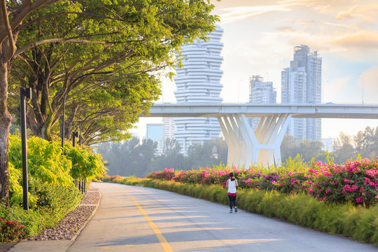 Jogger at Marina Bay East park at sunset